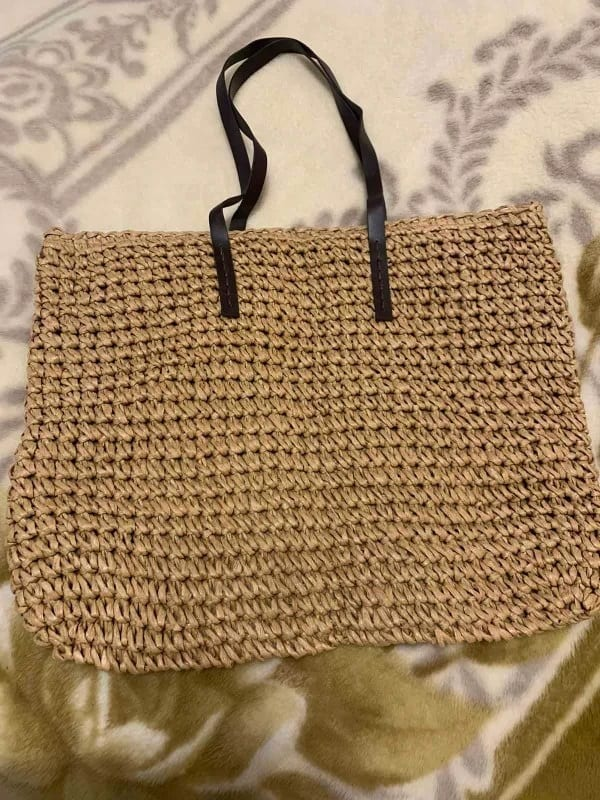 Which navy round straw bag