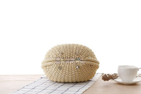 What beige straw clutch bag value