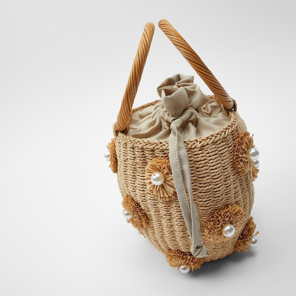 Which designer straw handbag with flowers