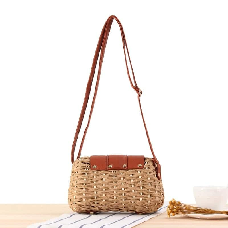 How khaki large straw beach bag suggest