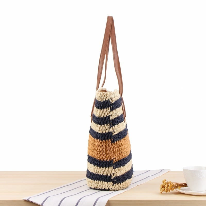Which beige woven purse