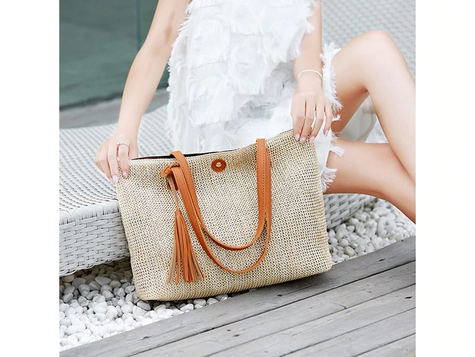 How many straw and leather handbag with flowers