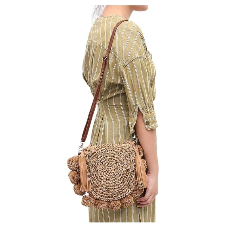 Stripped straw and leather handbag