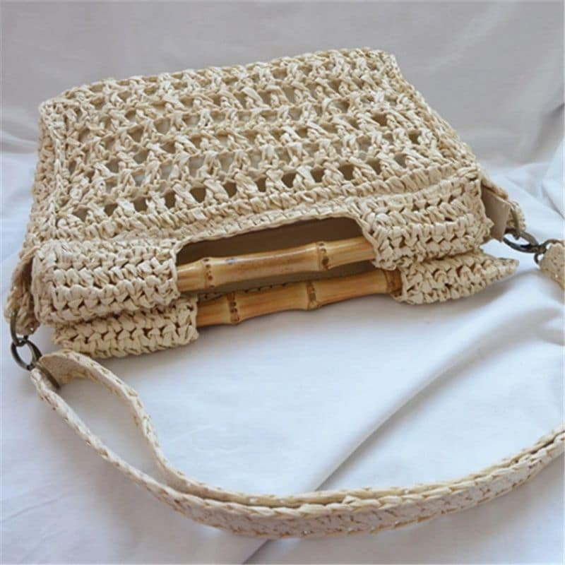 Where solid straw clutch bag