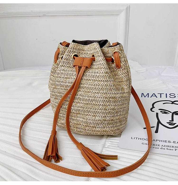How long knitted straw and leather handbag