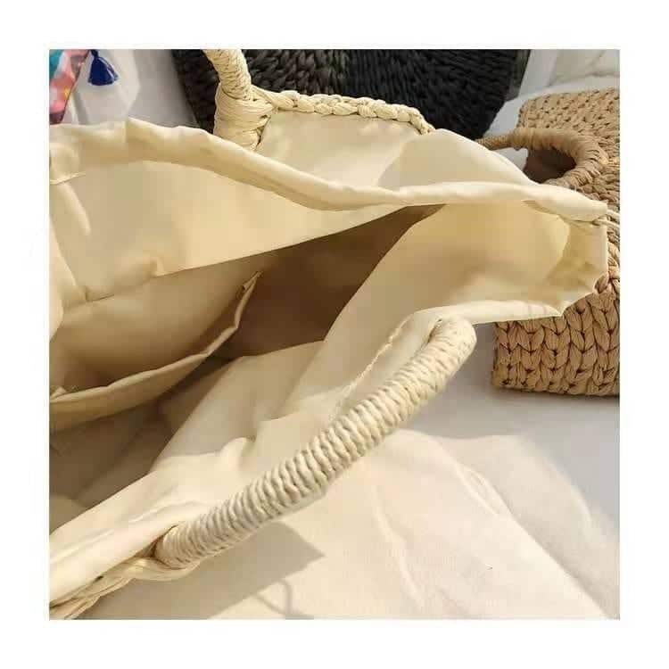 What oversized straw beach bag with zipper