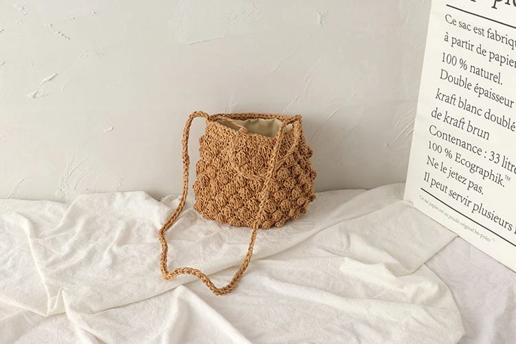 What solid designer straw bag top