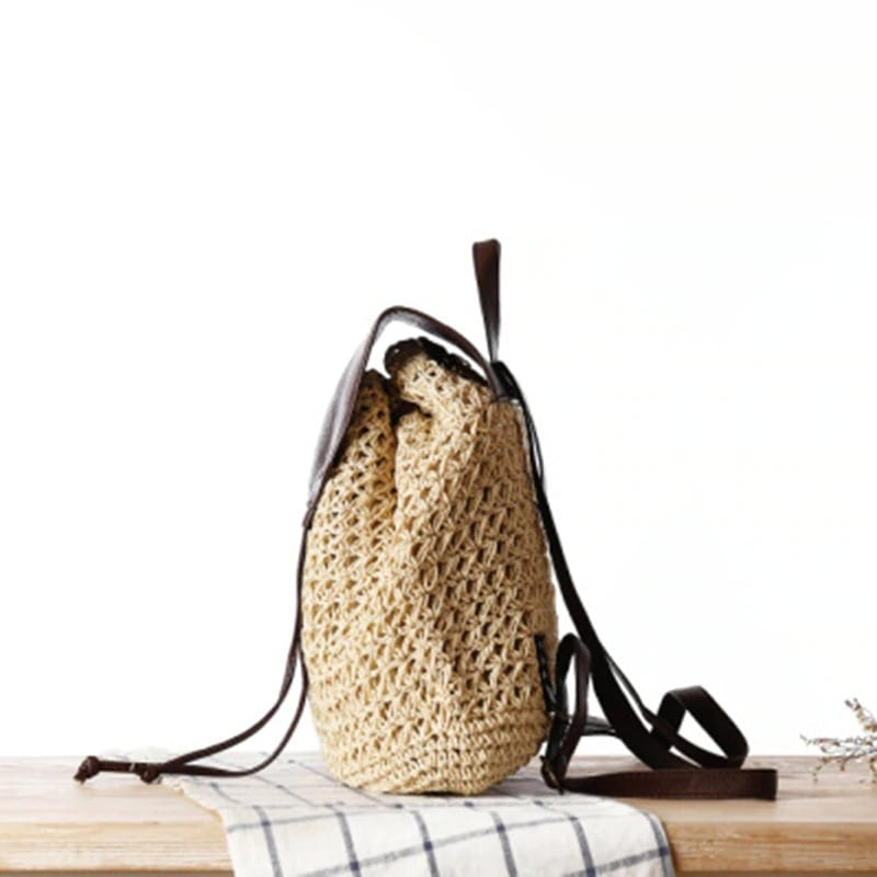 How much straw bag with leather handless clutch better
