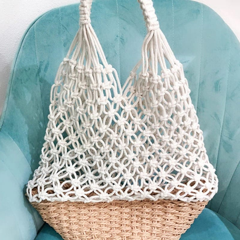 How long straw bag with leather handles and clutches